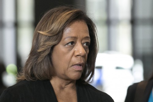 FILE - In this Oct. 13, 2015 file photo, former Chicago Public Schools CEO Barbara Byrd-Bennett apologizes to students, parents and educators before leaving federal court in Chicago after she pleaded guilty to her role in a kickback scheme. Detroit Public Schools says authorities are investigating contracts awarded by Byrd-Bennett during her tenure as chief academic and accountability auditor for the Detroit schools when that district awarded contracts worth about $3.4 million to Synesi Associates, one of the companies named in the Chicago indictment along with its co-owners. (Ashlee Rezin/Sun-Times Media via AP, File)  MANDATORY CREDIT, MAGS OUT, NO SALES; CHICAGO TRIBUNE OUT