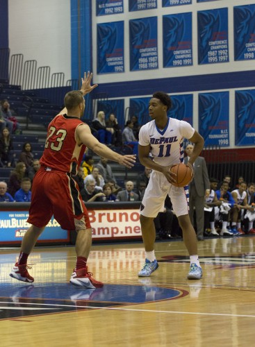 Freshman Eli Cain faces up a Caldwell defender. Cain scored seven points and had four assists as DePaul won its lone exhibition game Saturday 82-52.