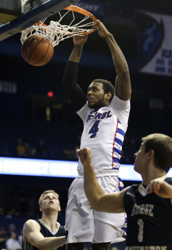 DePaul forward Myke Henry (4) dunks against George Washington during the second half of an NCAA college basketball game on Tuesday, Dec. 22, 2015, in Rosemont, Ill. DePaul won 82-61. (AP Photo/Nam Y. Huh)