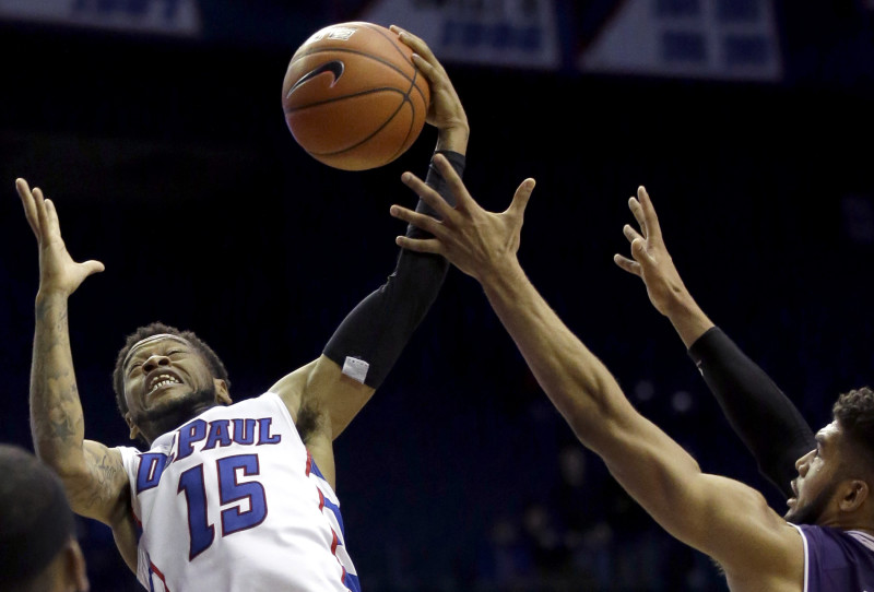 DePaul guard Aaron Simpson, left, rebounds the ball against Northwestern guard/forward Sanjay Lumpkin during the second half of an NCAA college basketball game on Saturday, Dec. 19, 2015, in Rosemont, Ill. Northwestern won 78-70 in overtime. (AP Photo/Nam Y. Huh)
