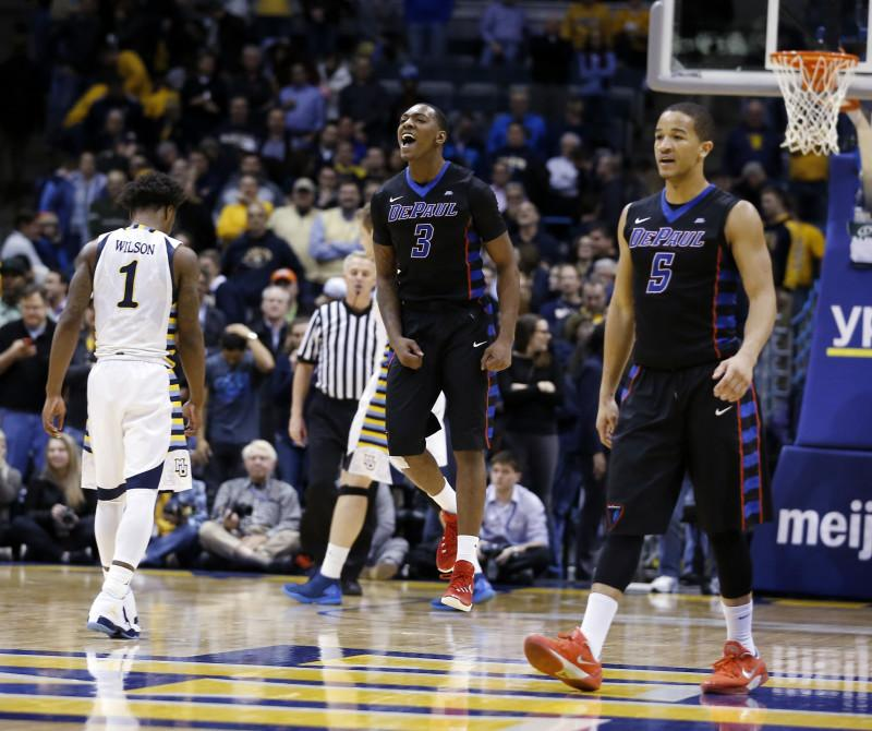 DePaul's Rashaun Stimage (3) and Billy Garrett Jr. (5) celebrate after an NCAA college basketball game against Marquette Wednesday, Jan. 20, 2016, in Milwaukee. DePaul won 57-56. (AP Photo/Morry Gash)