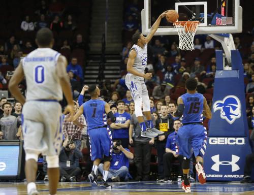 Seton Hall forward Desi Rodriguez, center, dunks against DePaul during the first half of an NCAA college basketball game, Saturday, Jan. 2, 2016, in Newark, N.J. (AP Photo/Julio Cortez)