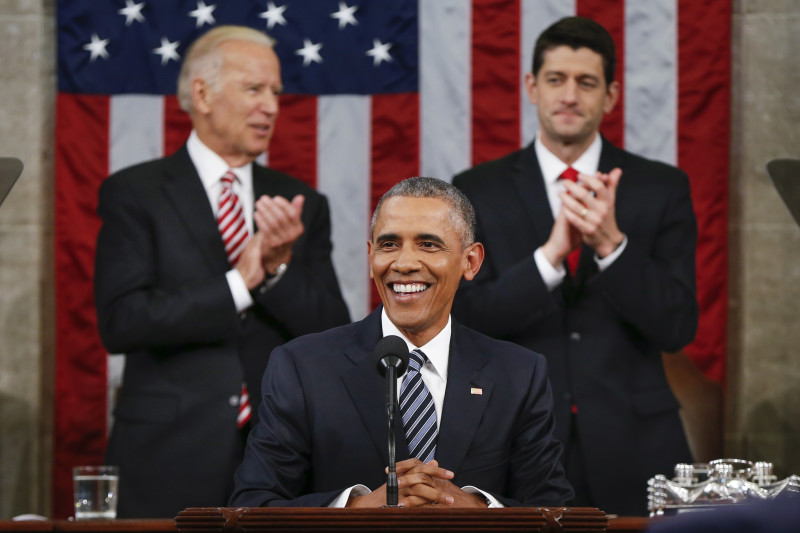 Vice President Joe Biden, left, and House Speaker Paul Ryan of Wisconsin applaud President Barack Obama during the State of the Union address before a joint session of Congress on Capitol Hill in Washington, Tuesday, Jan. 12, 2016. (AP Photo/Evan Vucci, Pool)