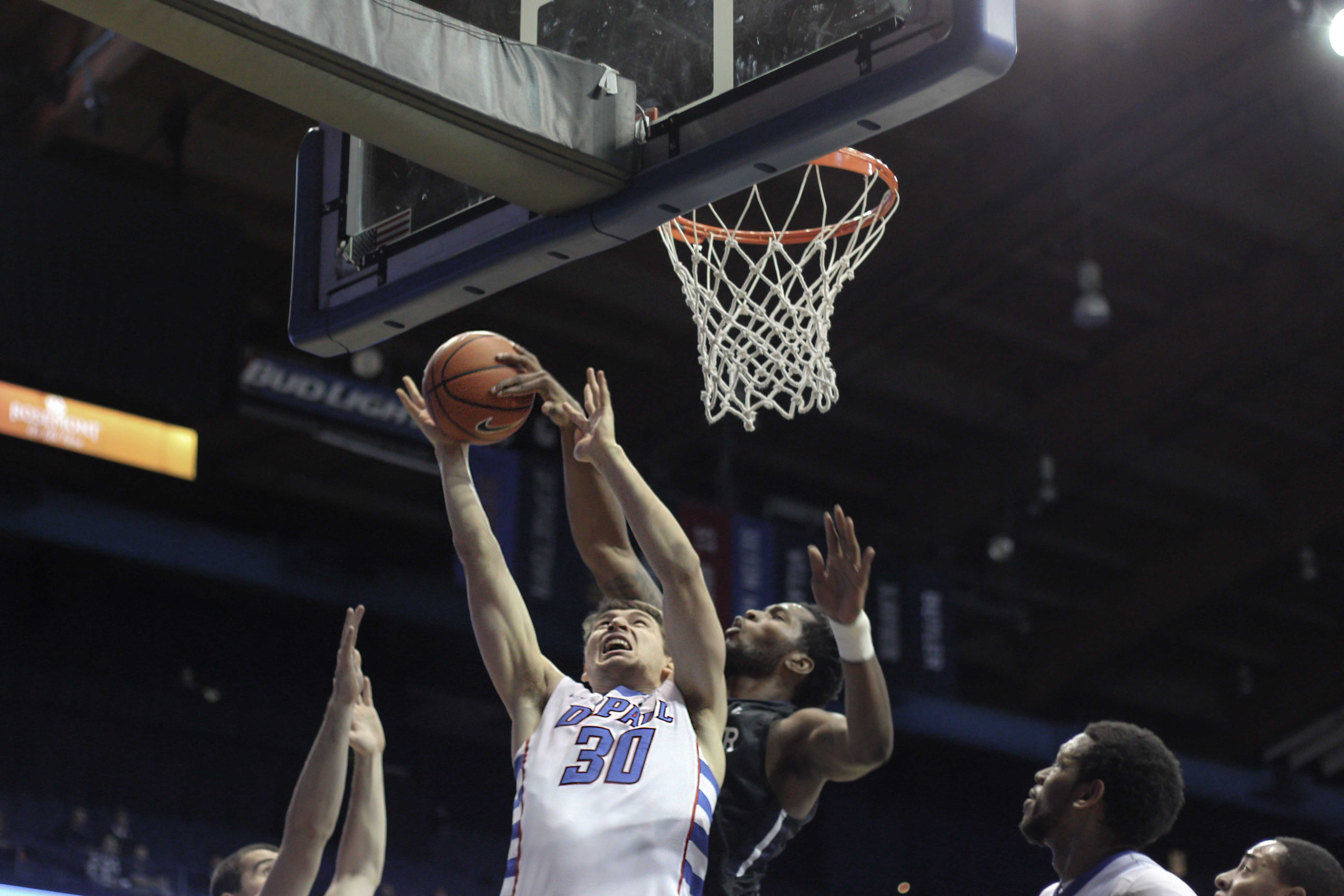 Junior Peter Ryckbosch (left) goes up for a basket against Butler. (Blake Schlin / The DePaulia)