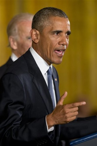 His cheeks wet with tears, President Barack Obama, accompanied by Vice President Joe Biden, speaks about the youngest victims of the Sandy Hook shootings, Tuesday, Jan. 5, 2016, in the East Room of the White House in Washington, where he spoke about steps his administration is taking to reduce gun violence. (AP Photo/Jacquelyn Martin)