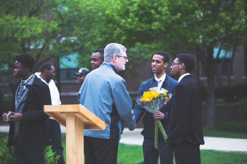 Rev. Dennis Holtschneider, C.M. attends an on-campus vigil last May for Rekia Boyd, an African-American woman killed by an off-duty police officer.