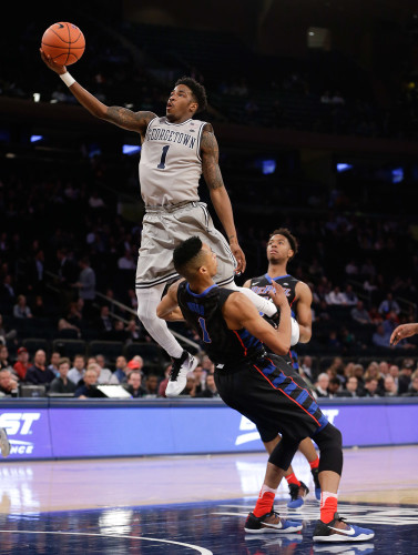 Georgetown guard Tre Campbell, top, shoots shot against DePaul guard Darrick Wood (1) in the first half of an NCAA college basketball game during the Big East men's tournament Wednesday, March 9, 2016, in New York. Campbell was called for an offensive foul on the play. (AP Photo/Julie Jacobson)