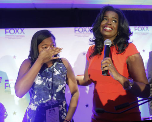 Challenger Kim Foxx , right, smiles at the crowd as her daughter Kai, wipes tears from eyes, as they celebrate Foxx's primary win over incumbent Democratic Cook County State's Attorney Anita Alvarez Tuesday, March 15, 2016, in Chicago. (AP Photo/Charles Rex Arbogast)