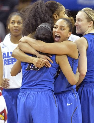 DePaul's Jessica January (14) hugs Chanise Jenkins following their win over Louisville in a second-round women's college basketball game in the NCAA Tournament in Louisville, Ky., Sunday, March 20, 2016. (AP Photo/Timothy D. Easley)