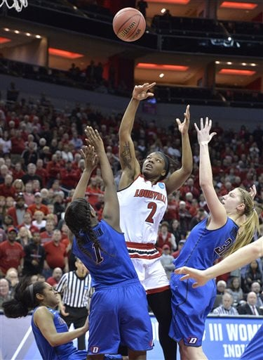 Louisville's Myisha Hines-Allen (2) charges before taking the possible winning shot against the defense of, from left, DePaul's Chanise Jenkins (13), Ashton Millender (1), and Megan Podkowa (30) during the second half of a second-round women's college basketball game in the NCAA Tournament in Louisville, Ky., Sunday, March 20, 2016. (AP Photo/Timothy D. Easley)