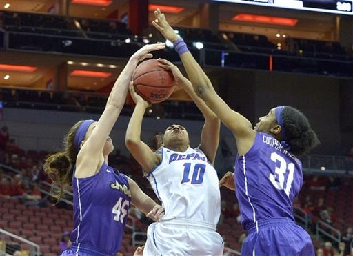 DePaul's Amarah Coleman (10) attempts a shot through the defense of James Madison's Kayla Cooper-Williams (31) and Savannah Felgemacher (45) during the second half of a first-round women's college basketball game in the NCAA Tournament in Louisville, Ky., Friday, March 18, 2016. DePaul won 97-67. (AP Photo/Timothy D. Easley)