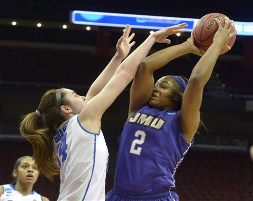 James Madison's Destiny Jones (2) attempts a shot over the defense of DePaul's Jacqui Grant (34) during the first half of a first-round women's college basketball game in the NCAA Tournament in Louisville, Ky., Friday, March 18, 2016. (AP Photo/Timothy D. Easley)