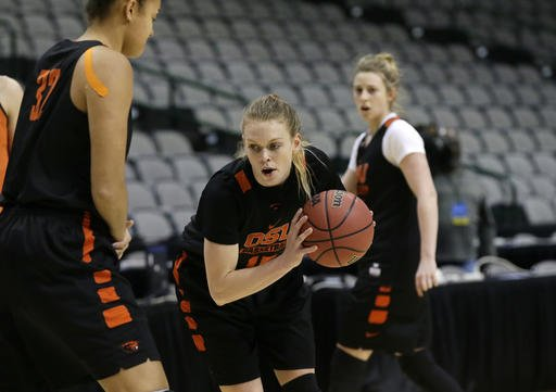 Oregon State guard Jamie Weisner (15) runs a drill with teammate forward Deven Hunter (32) during a college basketball practice in the regional semifinals of the women's NCAA Tournament, Friday, March 25, 2016, in Dallas. Oregon State takes on DePaul on Saturday. (AP Photo/LM Otero)