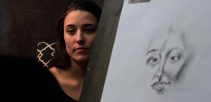 DePaul student challenges herself to draw 100 portraits in 100 days