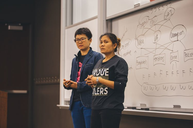 Noi Supalai (right), a former garment worker from Bangkok, Thailand spoke to DePaul students Thursday about her experiences working at a Thai clothing factory. (Josh Leff / The DePaulia)