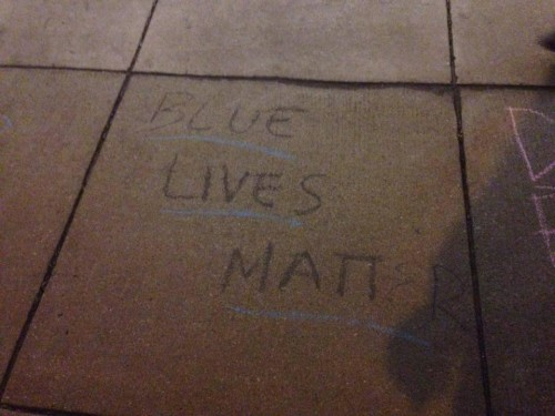 """Blue Lives Matter"" was chalked by College Republicans on campus earlier this month. Phrases like this and ""Build a wall"" sparked a controversy on campus regarding free speech and racism.  (Photo courtesy of DEPAUL COLLEGE REPUBLICANS)"