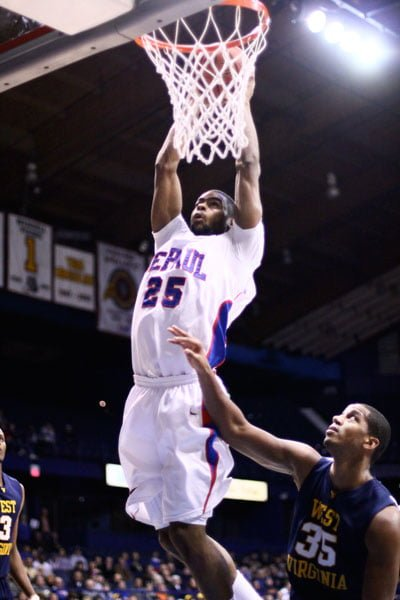 Former DePaul player Eric Wallace dunks a ball in 2009. Wallace has since played Australian rules football and is now pursuing an NFL career. (DePaulia File)