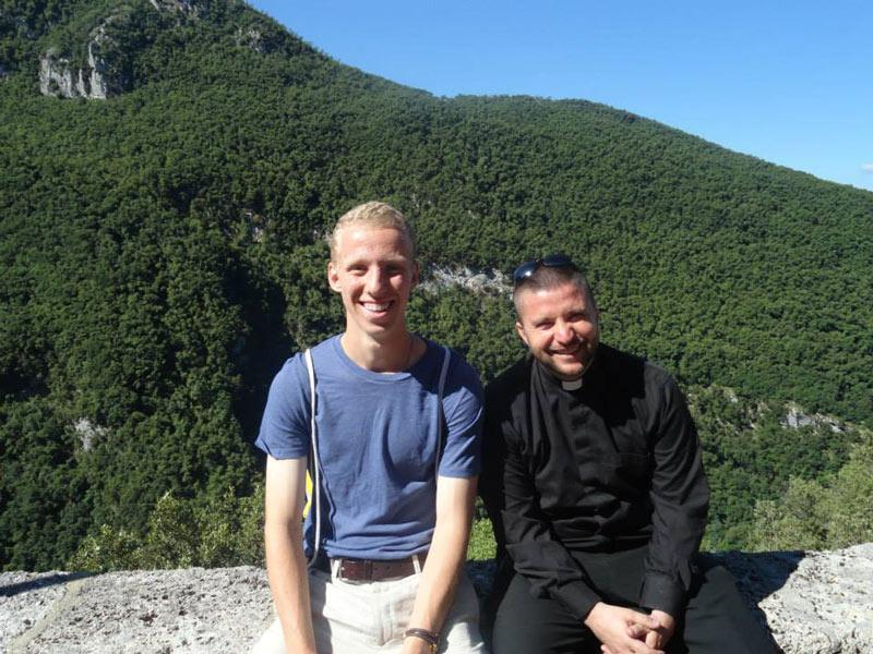 DePaul sophomore Ryan Martire sits with the Rev. Joshua Waltz in Subiaco, Italy. Waltz encouraged Martire to go to daily Mass, which played a large role in his faith.  (Photo courtesy of Ryan Martire)