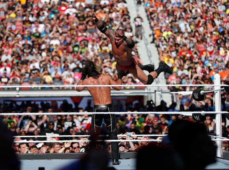 Randy Orton dives on Seth Rollins at Wrestlemania 31 in April, 2015 at Levi's Stadium in Santa Clara, California. (Nhat V. Meyer / MCT)