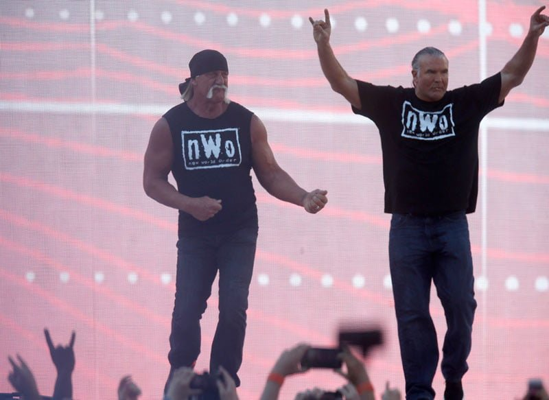 Hulk Hogan (left) and Scott Hall enter at Wrestlemania 31 to interfere in a match. (Nhat V. Meyer / MCT)