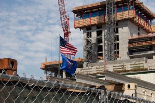 A DePaul flag flies above the construction site of the DePaul arena. (Megan Deppen / The DePaulia)