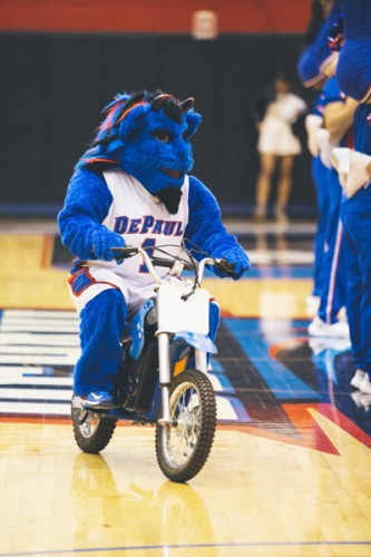 DIBS. which stands for Demon in a Blue Suit, performs at a Jan. 29 women's basketball game.  (Josh Leff / The DePaulia)
