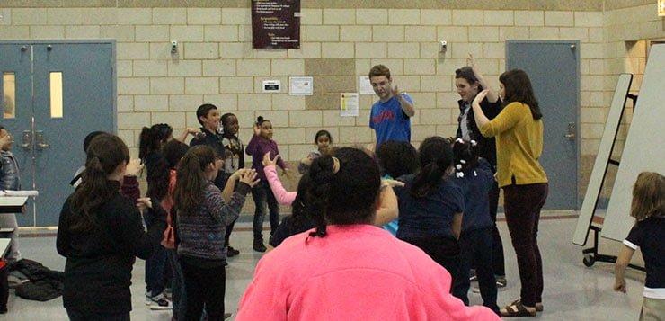 DePaul students direct performance at Bernhard Moos Elementary School