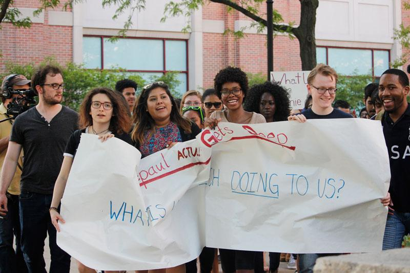 Protesters march from the Quad to the Student Center, where Yiannopoulos was speaking Tuesday. (Kirsten Onsgard / The DePaulia)