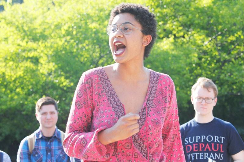 Anais Donald speaks to students gathered in the Quad. (Kirsten Onsgard / The DePaulia)