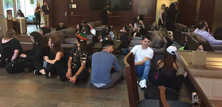Students stage sit-in, vent over campus tensions