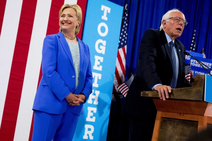 Democratic+presidential+candidate+Hillary+Clinton+listen+as+Sen.+Bernie+Sanders%2C+I-Vt.+speaks+during+a+rally+in+Portsmouth%2C+N.H.%2C+Tuesday%2C+July+12%2C+2016%2C+where+Sanders+endorsed+Clinton+for+president.+%28Andrew+Harnik+%7C+AP%29