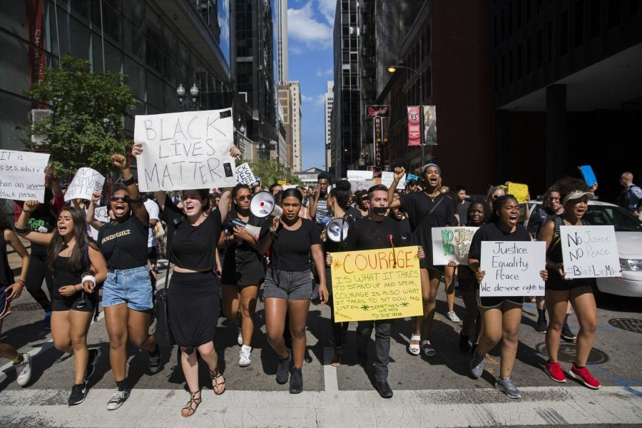 Protesters march from Millennium Park to the Federal Plaza Monday afternoon