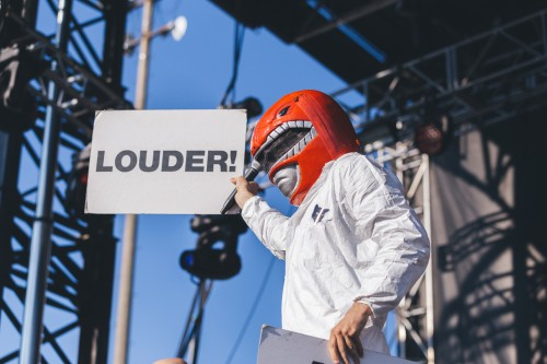 Lead singer of Super Furry Animals Gruff Rhys directed the audience with cue cards and sang through a helmet during their Saturday performance at Pitchfork Music Festival.