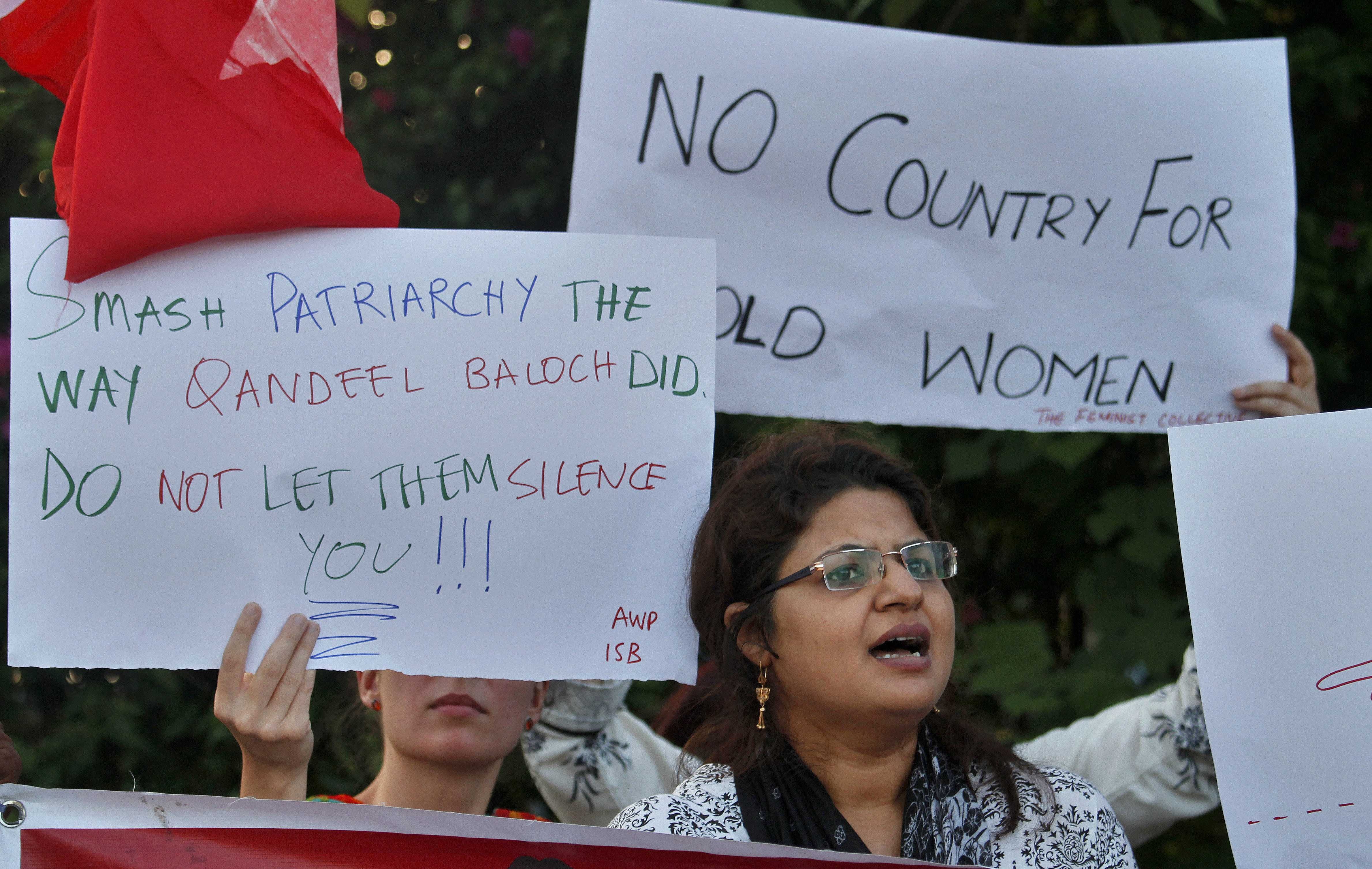 An Activist of the Awami Workers Party chants slogans during a demonstration to condemn the killing of model Qandeel Baloch and against honor killings, in Islamabad, Pakistan. Nearly 1,000 women are murdered in Pakistan each year for violating conservative norms on love, marriage and public behavior. The so-called