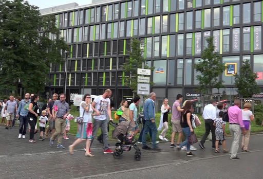 People leave a mall in Munich after a shooting Friday,  July 22, 2016. A manhunt is underway for the shooter or shooters who opened fire at the shopping mall, killing and wounding several people, a Munich police spokeswoman said. The city transit system shut down and police asked people to avoid public places. (Nonstop News | AP)