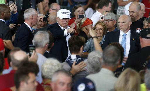 Republican presidential candidate Donald Trump greets the crowd after speaking at Joni's Roast and Ride at the Iowa State Fairgrounds, in Des Moines, Iowa, Saturday, Aug. 27, 2016. He will speak about his immigration policy Wednesday, Aug. 31. (Gerald Herbert | AP Photo)