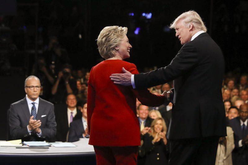 Democratic presidential nominee Hillary Clinton and Republican presidential nominee Donald Trump shake hands during the presidential debate at Hofstra University in Hempstead, N.Y., Monday, Sept. 26, 2016. (Joe Raedle/Pool via AP)