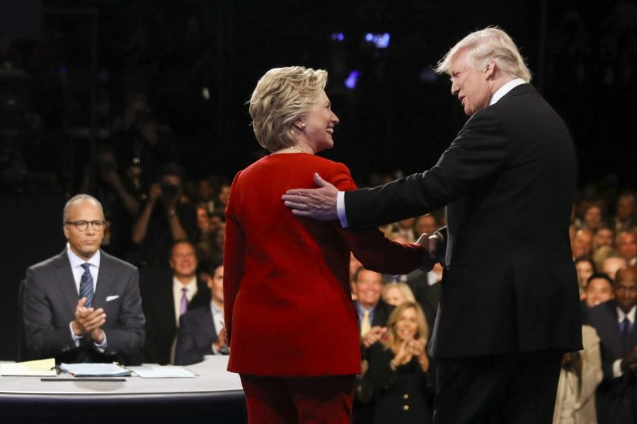 Democratic presidential nominee Hillary Clinton and Republican presidential nominee Donald Trump shake hands during the presidential debate at Hofstra University in Hempstead, N.Y., Monday, Sept. 26, 2016. (Joe Raedle/Pool via AP)