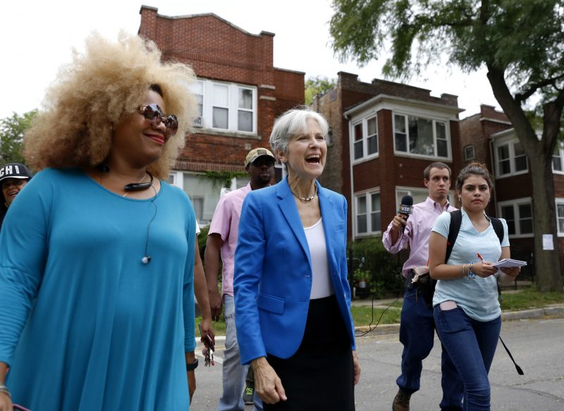 Green Party presidential candidate Jill Stein, center, walks on South Austin neighborhood with community activist Zerlina Smith in Chicago. (Tae-Gyun Kim/AP)