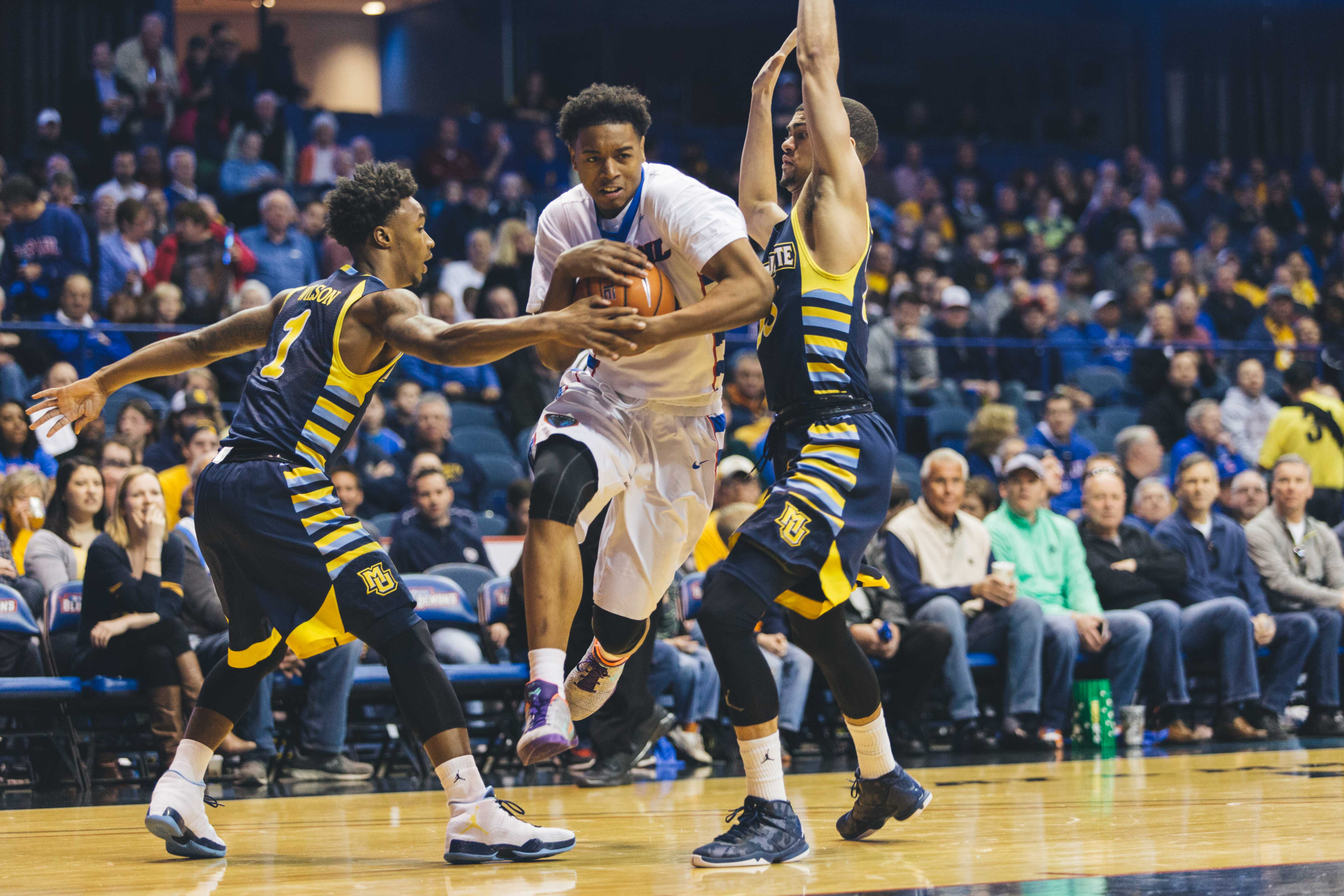 DePaul sophomore guard Eli Cain drives the ball through Marquette's defense last season. (Photo by Josh Leff / The DePaulia)