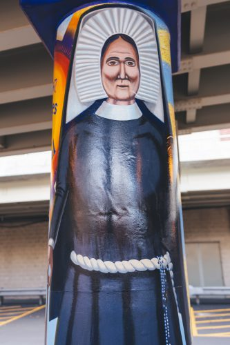 """Murals painted underneath the Fullerton """"L"""" station depict basketball coach Ray Meyer, Olympic athlete Dolly Staton and DePaul alum and civil rights activist Benjamin Hooks. (Photo by Josh Leff / The DePaulia)"""