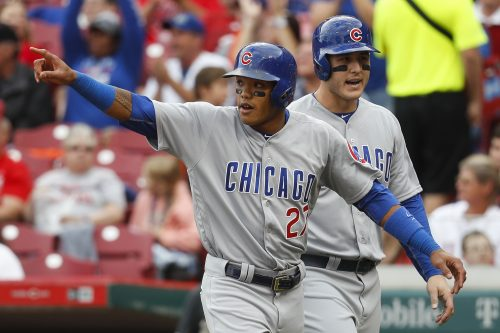 Addison Russell celebrates a run in a game against the Reds in September. (John Minchillo/AP)