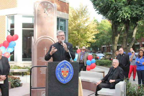 President Rev. Dennis Holtschneider, C.M., addresses a crowd outside Arts and Letters Hall on Sept. 27. (Chris Schafale/The DePaulia)