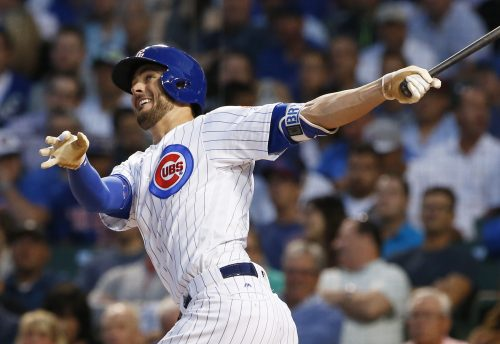 In this Aug. 31, 2016, file photo, Chicago Cubs' Kris Bryant follows through on a solo home run during the first inning of a baseball game against the Pittsburgh Pirates, in Chicago. Bryant, Bryce Harper and Big Papi are just a few of the big-name offensive stars leading their teams into the postseason. (AP Photo/Nam Y. Huh, File)