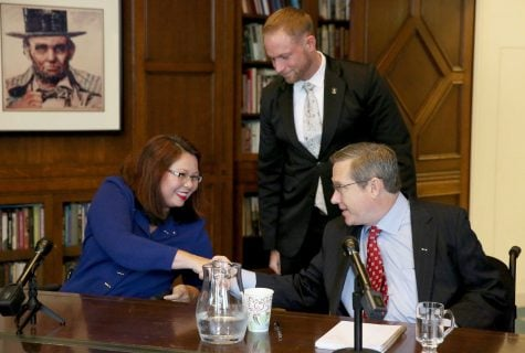 U.S. Senate candidates Rep. Tammy Duckworth and Sen. Mark Kirk shake hands after their debate on Monday Oct. 3, 3016 in the Chicago Tribune editorial board room. (Nancy Stone/Chicago Tribune via AP)