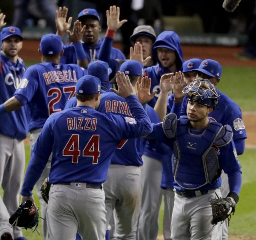 Members of the Chicago Cubs celebrate their win against the Cleveland Indians after Game 2 of the Major League Baseball World Series Wednesday, Oct. 26, 2016, in Cleveland. The Cubs won 5-1 to tie the series 1-1. (AP Photo/Charlie Riedel)