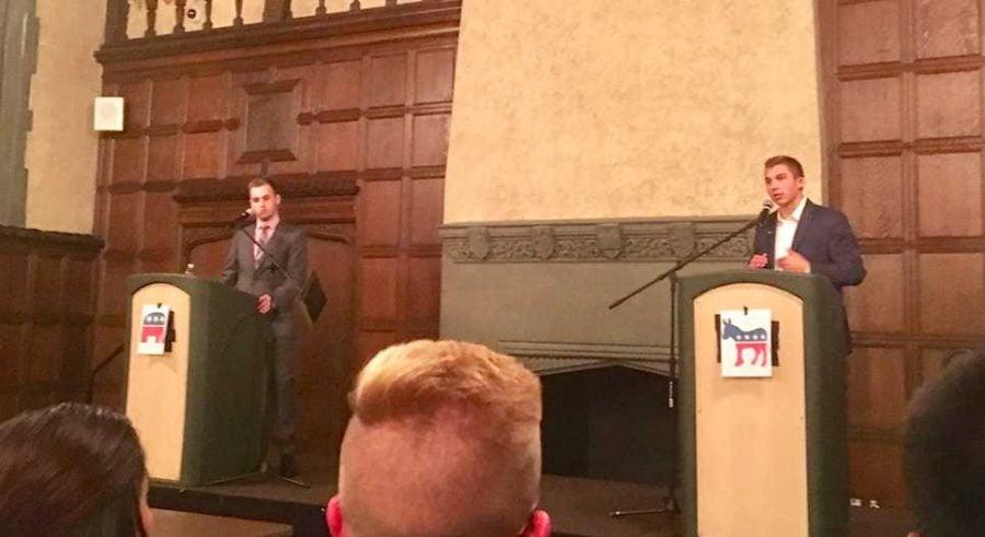 DePaul students John Minster and Jack McNeil debate Monday night. (Courtesy of Evan Keller)