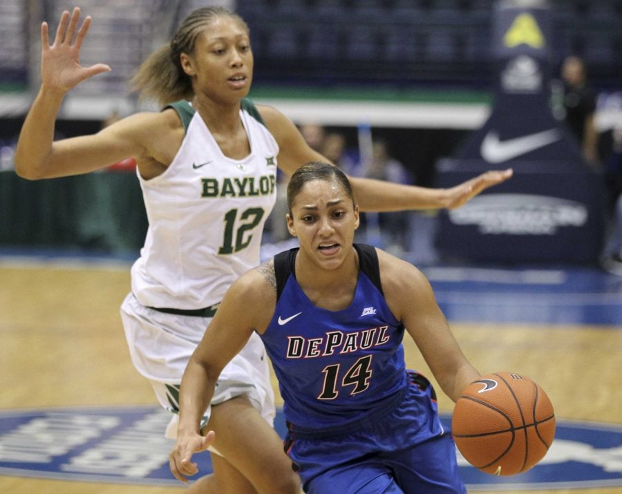 Former DePaul guard Jessica January (14) averaged 16.9 points, 6.6 rebounds and 4.2 assists for CSU Universitatea Alba Iulia in Romania.(AP Photo/Luis M. Alvarez)