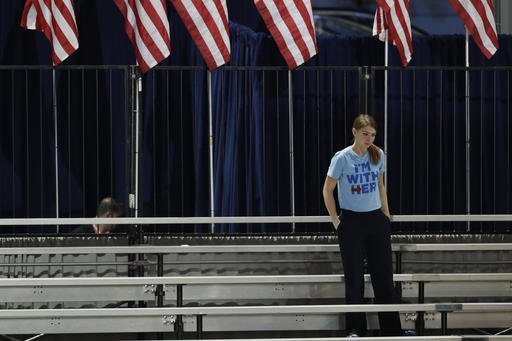 A Clinton supporter stands alone in the bleachers after Democratic presidential nominee Hillary Clinton's election night rally was canceled at the Jacob Javits Center in New York, Wednesday, Nov. 9, 2016. (Patrick Semansky | AP Photo)