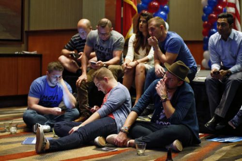 Democratic supporters of Hillary Clinton check results as Donald Trump began to pick up wins in key states, while watching results come in at the Dallas County Democrats party at Hyatt Regency in Dallas, Texas, late on Tuesday, Nov. 8, 2016. (Nathan Hunsinger/The Dallas Morning News via AP)